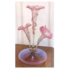 Exquisite Victorian era pink glass epergne with fluted base and three ruffled flutes