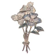 Costume jewelry floral pin blue enamel & rhinestones
