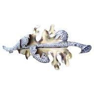 Deja gold washed rhinestone curled leaf pin