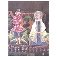Tiny wooden bookends handpainted in English costumed people