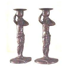 Pair of Art Deco semi nude bronze candlesticks after Muller