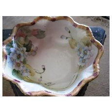 Vintage Nippon bowl with floral design and gold trim