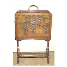 Scottish Arts & Crafts oak magazine rack with painted tooled leather