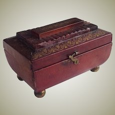 Miniature Regency red leather sewing box and contents