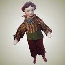 Sweet little 1860s Parian dolls house boy