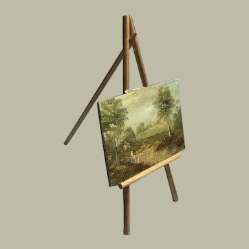 Charming oil painting on easel for display with dolls