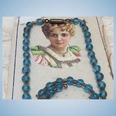 """Jumeau Blue"" Czech Glass Doll Necklace on Original Card"