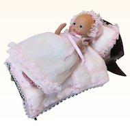 Vintage Bisque Baby in Wooden Cradle