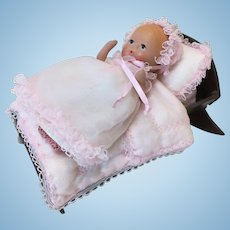 Vintage Bisque Baby in Wooden Cradle