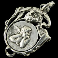 Antique French Continental Silver Cherub Angel Cupid Putti with Tulip Floral Surround Pendant Charm Religious Crib Medal - Good Condition
