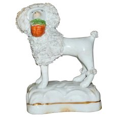 Mid-19th Century Victorian Staffordshire Poodle with Basket on Base