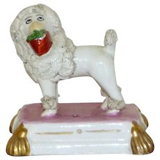 Early 19th Century Staffordshire Poodle with Basket of Greenery in Its Mouth
