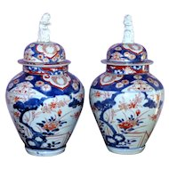 Pair of 18th Century Edo Period Imari Baluster Vases with Foo Dog Tops