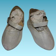 "Antique or vintage white leather doll shoes. 3 1/2"" long X 1 1/2"" wide in size. Your dolls foot must be smaller than the measurements given!"
