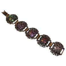 "Vintage Judy Lee metal bracelet, 7 1/2"" long around the wrist. 1 3/8"" wide, multi color enamel like design, Gold tone color, no stones."