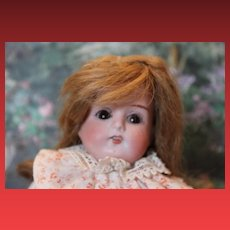 """Armand Marseille, AM, Mabel doll, German Antique doll, 12"""" tall, sleep eyes, leather shoes, replaced arms, repair on top of leather foot. Bisque shoulderhead."""