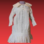 "Great old 1980's  thick cotton doll dress, Lots of decorative buttons up the front of the dress. Fits a 14-15"" tall doll! White color, with some age stains. Vintage or Antique doll dress."