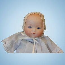 """Sweet 9 1/2"""" -10"""" long German Antique Armand Marseille, AM Baby Dream Baby, bisque head, original cloth body, cryer mechanism does not work, plastic hands."""