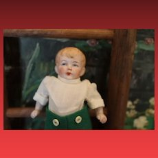 """Sweet German Antique all Bisque Boy Doll, 4 1/2"""" tall dollhouse doll, Incised """"Germany 2"""" on the back. 2 tiny chips on one upper thigh leg area. Sweet!"""