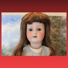 """22 1/2"""" tall Heubach Koppelsdorf German Bisque head, Antique Doll, mold number 2503, replaced antique hands and lower arm is replaced with antique parts."""