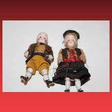 """Brother and sister all bisque German antique dolls. wire attached arms and legs. 4 1/4"""" tall, old clothes,  painted socks and shoes, clothes are sewn on."""