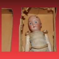 German Antique bisque head, compo body, Strobel & Wilken doll, In original box, no wig no hairlines. Made in Germany!