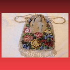 """Beautiful antique hand micro beaded purse! Measures  13 1/2"""" long  7 1/2"""" wide in size. Has one round spot that is damaged."""