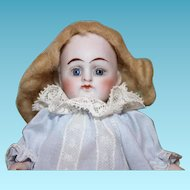 """Sweet little 5 1/2"""" tall all bisque German doll with blue glass sleep eyes, baby blue dress & pantaloons!"""