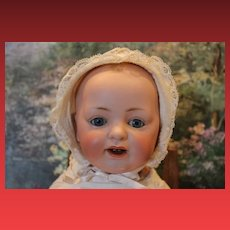 """16"""" long JDK Kestner Bisque head baby, antique, composition body, strung well, blue sleep eyes, 2 teeth, open mouth, painted hair, diaper, slip, gown, wear on neck and fingers."""
