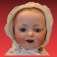 "16"" long JDK Kestner Bisque head baby, antique, composition body, strung well, blue sleep eyes, 2 teeth, open mouth, painted hair, diaper, slip, gown, wear on neck and fingers."