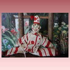 """Schoenhut Circus Clown in original Costume with hat, missing one ear and other ear is a replacement. Poseable, made of wood. 9"""" tall including hat!"""