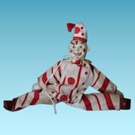 "Schoenhut Circus Clown in original Costume with hat, missing one ear and other ear is a replacement. Poseable, made of wood. 9"" tall including hat!"