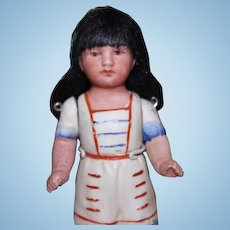 """4 1/2"""" tall German Antique Bisque Indian girl doll. Unmarked, all original with bisque arms."""