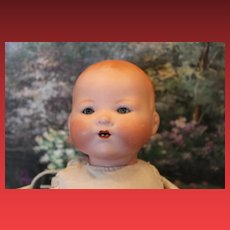 "14 1/2"" long, Armand Marseille, #351 Antique German baby, with blue sleep eyes, new body, bisque head, new hands."