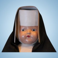 "Vintage Nun Doll in original costume, replaced legs with crazing on them. 13"" tall, composition doll"