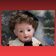 German Antique Revalo Doll, bisque head, composition baby body, wig pulls on forehead, sleepeyes, no hairlines, cracks on one hand, see photos.