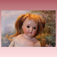 """A.T. Type German closed mouth Antique doll, 18"""" tall, Restored head, Incised letter C on shoulder, Kid body, bisque head and hands."""
