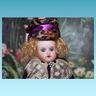 "German Antique Bisque head doll, 6 1/2"" tall, unknown maker, no hairlines, sleep eyes."