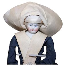 """All Original China Head Nun doll, original costume and rosary, 8 1/4"""" tall including her hat. China feet, cloth body."""