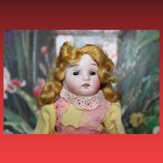 """Gebruder Kuhnlenz German all bisque doll, replaced arms, 2 chips on back of upper legs. 6 1/2"""" tall in size. Long painted stockings."""