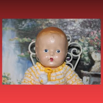 """American Composition doll, in yellow sweater set, great condition! 12"""" tall in size, can sit by himself and strung well!"""