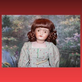 Damaged German Antique Doll with hairline and kid leather body and bisque lower arms.