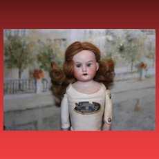 "13 1/2"" German Antique Florodora Doll, with hairline on the back of the head. Marked body!"