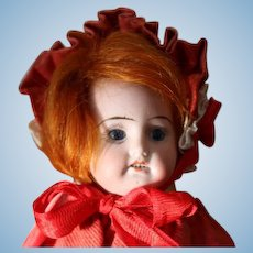 """8"""" bisque head doll, crude body, Red mohair, open mouth with teeth!"""