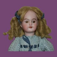 """7  1/2"""" tall German Doll with wood body"""