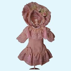 Pretty pink wool type fabric for your doll!