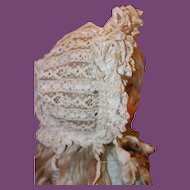 Great French  Lace & silk doll bonnet, with lots of silk ribbons on top and ruffles around the face!