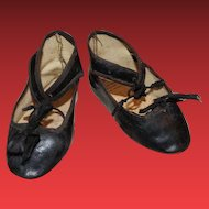 "Nice old Oil cloth doll shoes with silk bows and very nice condition! 4"" X 1 3/4"" in length.  black oilcloth."