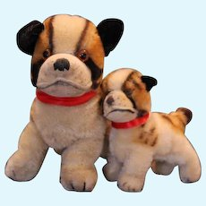 "Pair of Steiff Bully Bull dogs, 2 different sizes, 4"" tall and 6"" tall on the dogs.  One has  the original collar and the pin in the ear. The other does not have either."