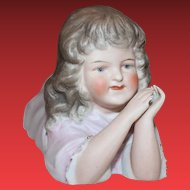Antique Sweet Girl figurine, laying on her tummy. Damage on inside of one hand, see picture.